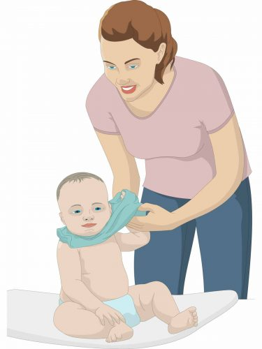 Mother taking baby's t-shirt off